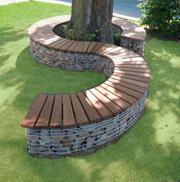 The hand-made gabions of the serpent, are integrated harmoniously in the garden of the image is a #ba...
